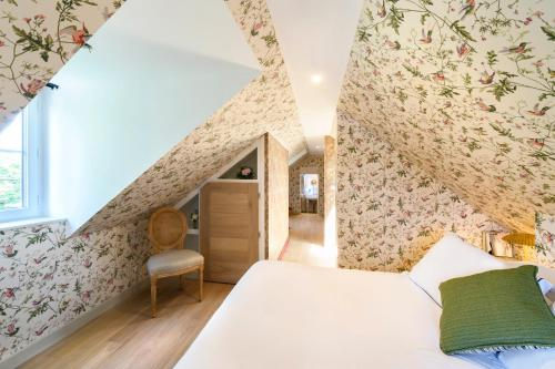 Un ou plusieurs lits dans un hébergement de l'établissement Domaine Saint Clair - Le Donjon