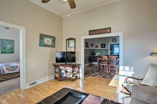 A television and/or entertainment center at Serendipity Cottage with Yard, Walk to Town and Dining!