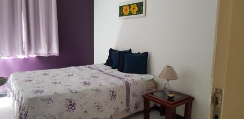 A bed or beds in a room at Apartamento Mobiliado - Aracaju