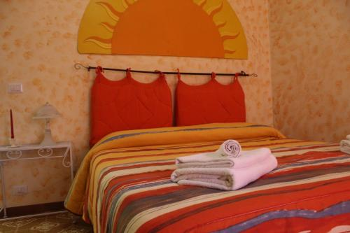 A bed or beds in a room at Casa Di Giomi