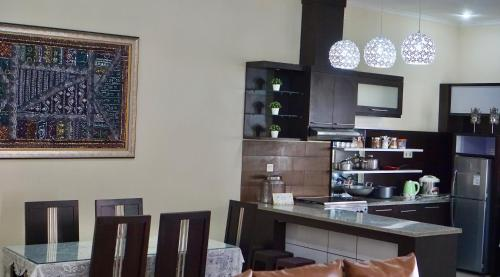 A restaurant or other place to eat at Sudji's House