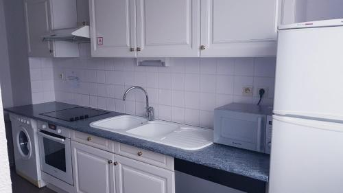 A kitchen or kitchenette at Appart'City Rennes Ouest