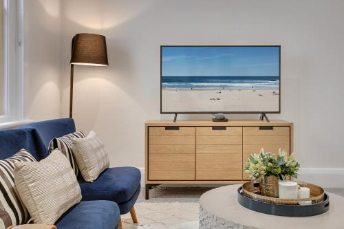 A television and/or entertainment center at Large, stylish and quiet penthouse steps from surf