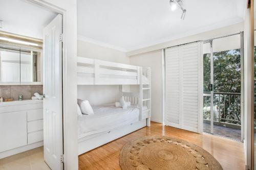 A bunk bed or bunk beds in a room at Classic Getaway Apartment For The Whole Family