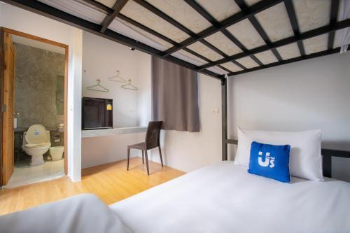 Säng eller sängar i ett rum på Samui Us hostel