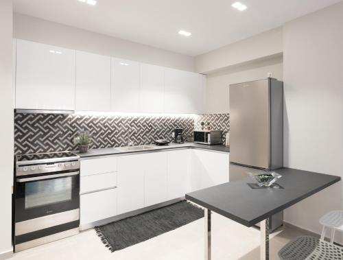 A kitchen or kitchenette at City Center Apartment in Great Location