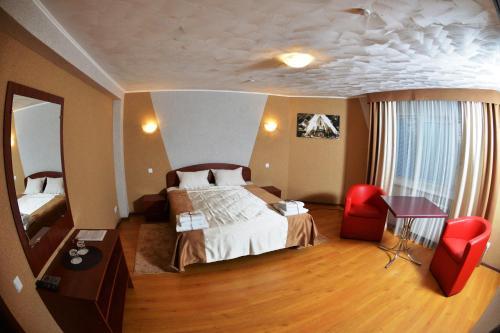 Ліжко або ліжка в номері Forsage