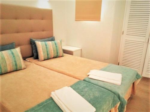 Cama o camas de una habitación en Albufeira Jardim