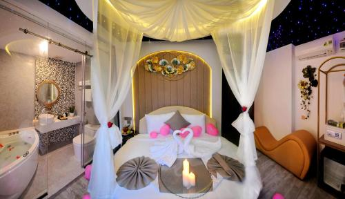 A bed or beds in a room at Alpha Bird Nha Trang Managed By VNServices