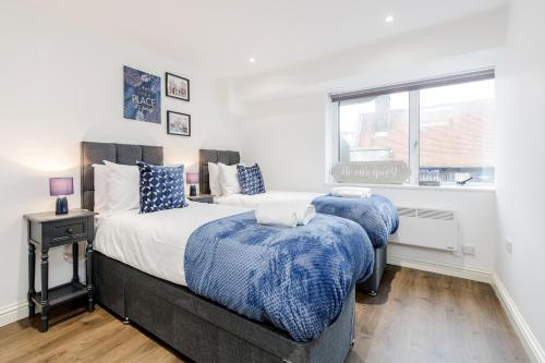 A bed or beds in a room at Watford Premier Serviced Apartments