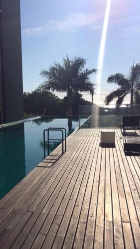 The swimming pool at or close to Quarto MaxHaus Praia Brava/BC