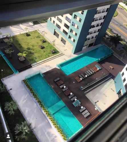 A view of the pool at Quarto MaxHaus Praia Brava/BC or nearby