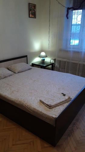 A bed or beds in a room at Apartments Zvezda Yugo-Zapad