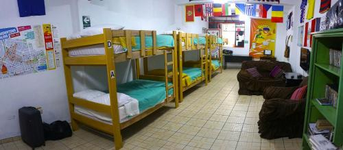A bunk bed or bunk beds in a room at Paypurix Hostel Lima Airport