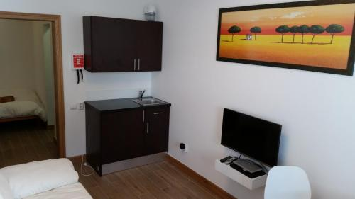 A television and/or entertainment center at Light Breeze