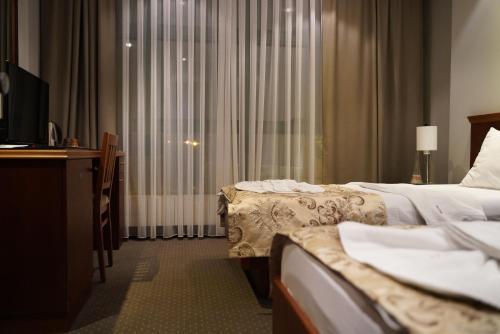 Krevet ili kreveti u jedinici u okviru objekta Hotel Tadz