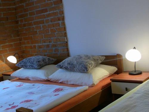 Postel nebo postele na pokoji v ubytování Apartments Kristic