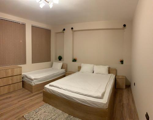 เตียงในห้องที่ Maison Blanche Guest Rooms