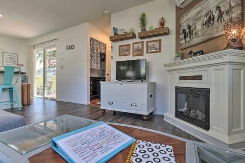A television and/or entertainment center at Prescott Cottage with Furnished Deck, Patio, and BBQ!