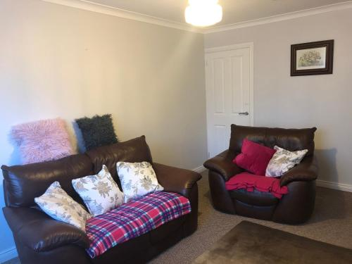 A seating area at Entire Cozy Home Well Equiped for Longer ! stays !