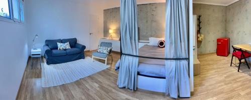 A bed or beds in a room at Estudio Las Piedras