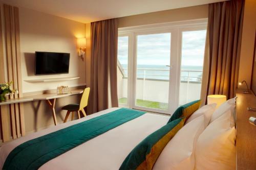 Un ou plusieurs lits dans un hébergement de l'établissement Hotel Le B d'Arcachon