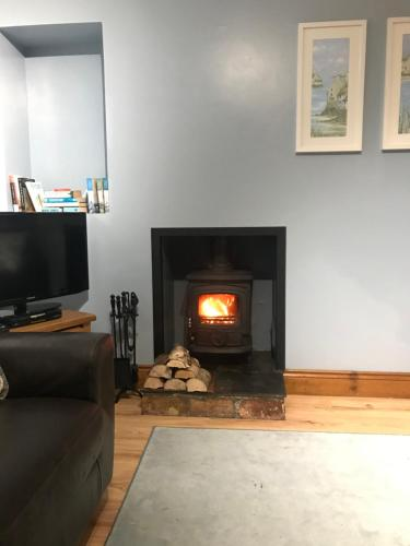 A television and/or entertainment center at Causeway Coast Cottage