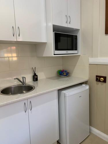 A kitchen or kitchenette at The Convent Boutique Accommodation & Cafe