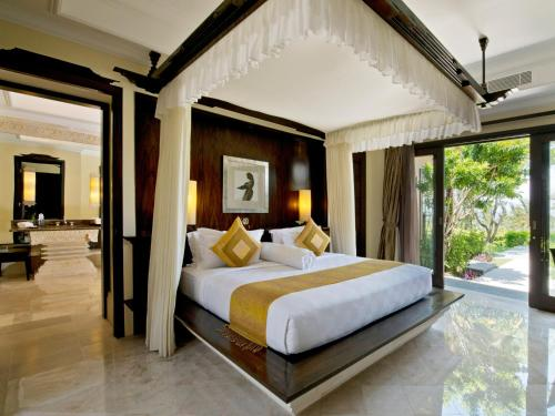 A bed or beds in a room at The Villas at AYANA Resort, BALI
