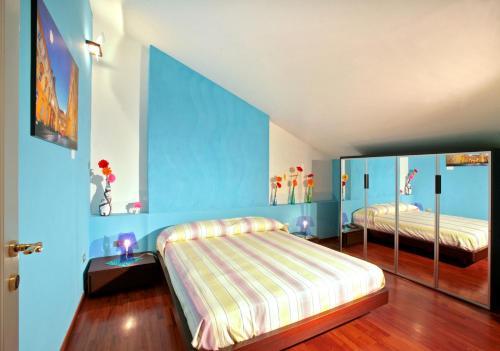 Letto o letti in una camera di Villa Quaranta