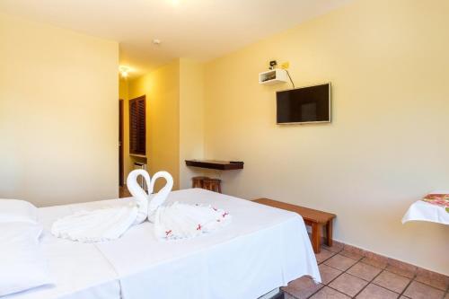 Cama ou camas em um quarto em Hotel Ponta das Toninhas