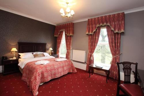 A bed or beds in a room at Farington Lodge Hotel