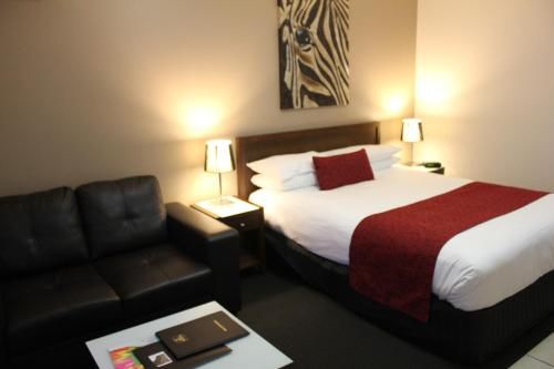 A bed or beds in a room at Best Western Ipswich
