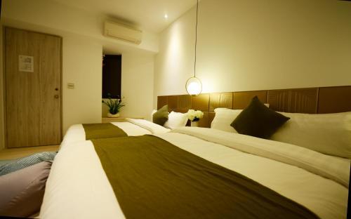 愉園房間的床