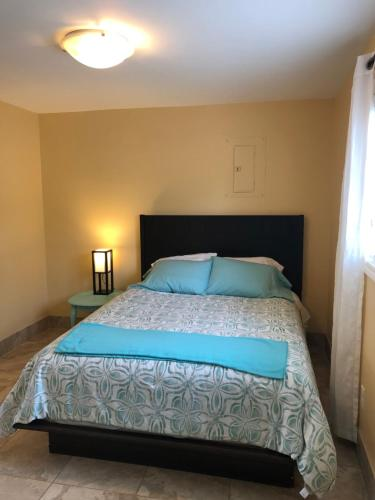 A bed or beds in a room at 561 Notre Dame St Apartment