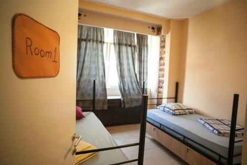 A bed or beds in a room at Hostel Han