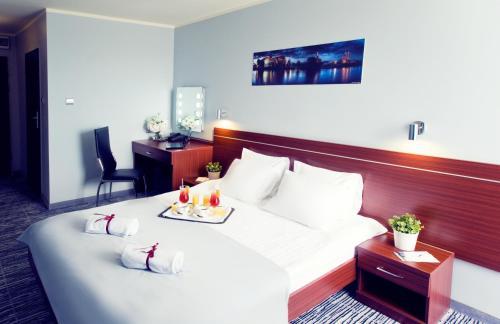 Łóżko lub łóżka w pokoju w obiekcie Hotel Śląsk