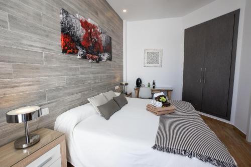 Cama o camas de una habitación en Hostal Casa Mercedes