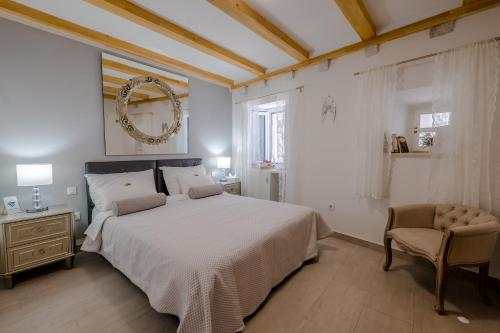 A bed or beds in a room at Apartments St. Michel