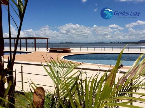 The swimming pool at or close to GOLDEN LAKE RESIDENCE ARRAIAL DO CABO