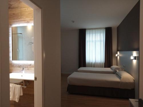 Cama o camas de una habitación en Hotel Seminario Aeropuerto Bilbao