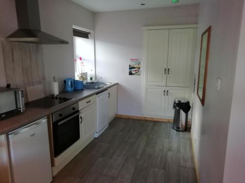 A kitchen or kitchenette at The River House Self Catering Apartment