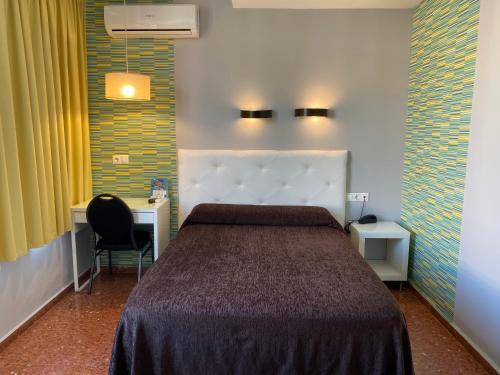 A bed or beds in a room at Estación