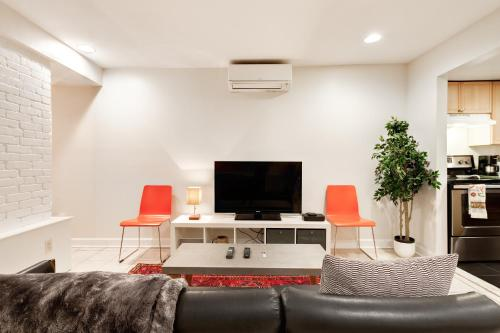 A television and/or entertainment center at Perfect DC Retreat!