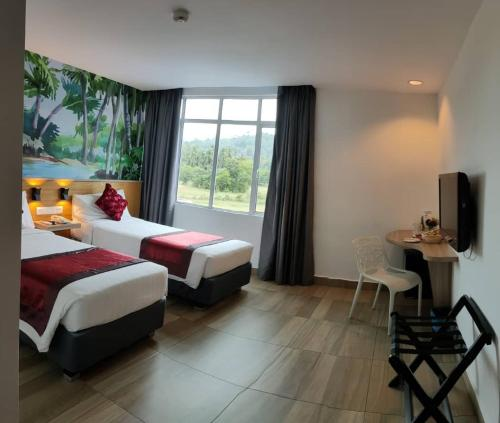 Katil atau katil-katil dalam bilik di favehotel Cenang Beach Langkawi