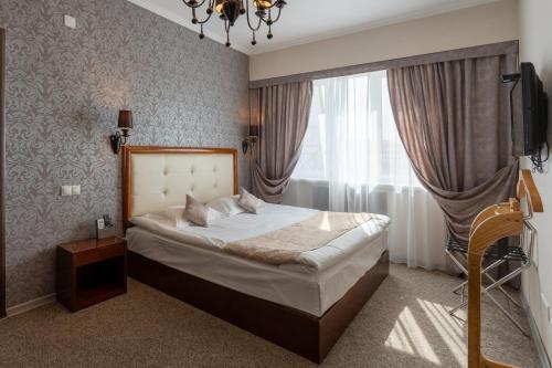 Кровать или кровати в номере Отель Европа