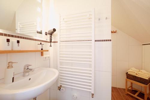 Ein Badezimmer in der Unterkunft Elbhof Harnisch