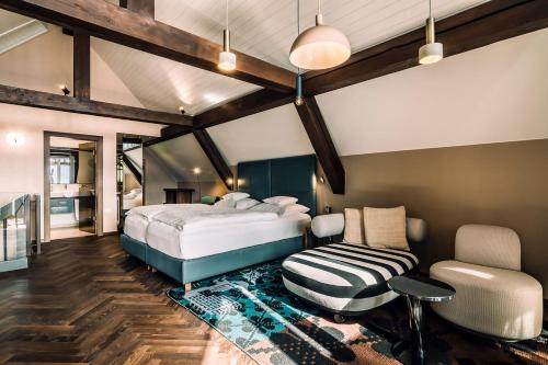 A bed or beds in a room at Miramonti Boutique Hotel