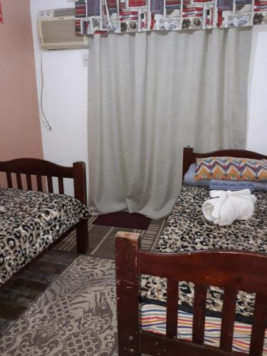 A bed or beds in a room at Pousada da Lu em Pelotas