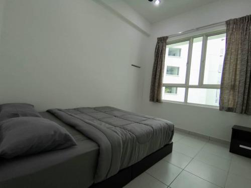 A bed or beds in a room at Penang Airport 3R3B Sierra Residence